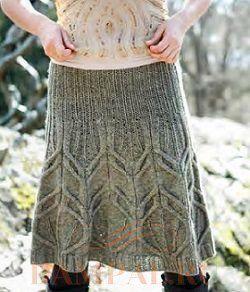 2. 1. Вязаная теплая юбка имеет расклешенный силуэт. . Верхняя часть юбки, связанная резинкой, плотно прилегает к